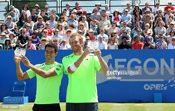Chris Guccione of Australia and Andre Sa of Brazil pose with their trophys after beating Pablo Cuevas of Uruguay and David Marrero of Spain during...