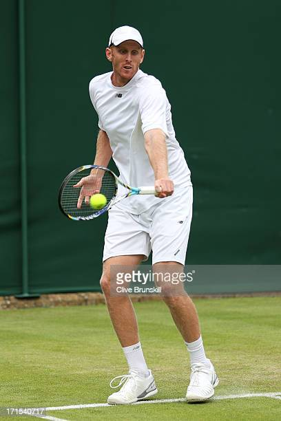 Chris Guccione of Australia plays a backhand during the Gentlemen's Doubles first round match between Samuel Groth and Chris Guccione of Australia...