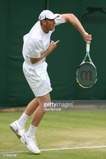 Chris Guccione of Australia serves during the Gentlemen's Doubles first round match between Samuel Groth and Chris Guccione of Australia and Steve...