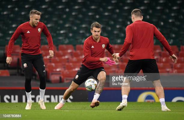 Chris Gunter looks on as Aaron Ramsey controls the ball during a Wales Training Session at Principality Stadium on October 10 2018 in Cardiff Wales