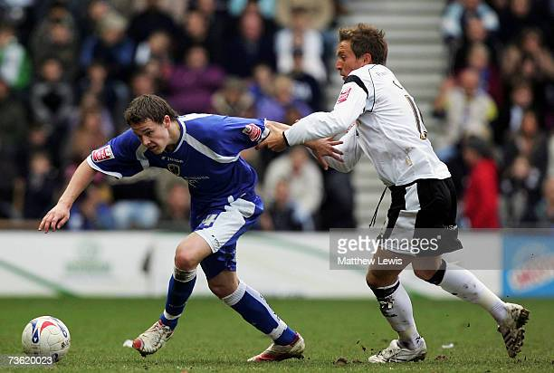 Chris Gunter of Cardiff and Darren Currie of Derby challenge for the ball during the CocaCola Championship match between Derby County and Cardiff...