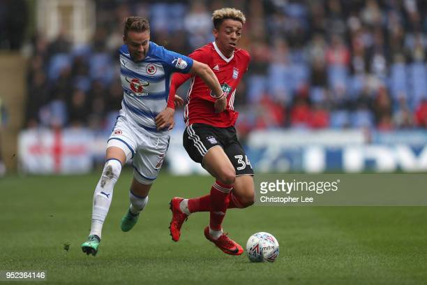 Chris Gunter of Reading battles with Ben Folami of Ipswich during the Sky Bet Championship match between Reading and Ipswich Town at Madejski Stadium...