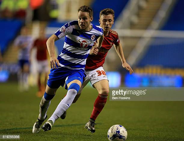 Chris Gunter of Reading holds off pressure from Ben Osborn of Nottingham Forest during the Sky Bet Championship match between Reading and Nottingham...