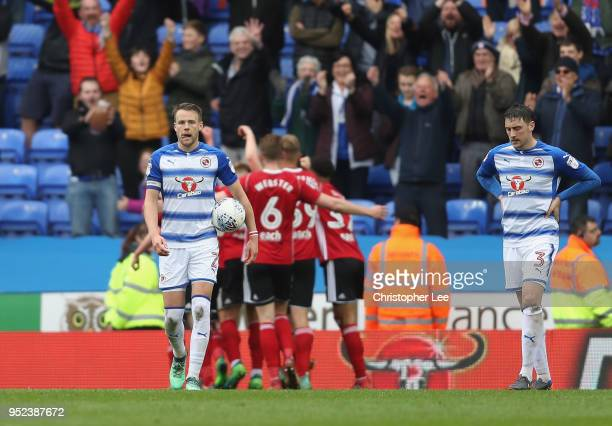 Chris Gunter of Reading look dejected as Ipswich celebrate their third goal during the Sky Bet Championship match between Reading and Ipswich Town at...
