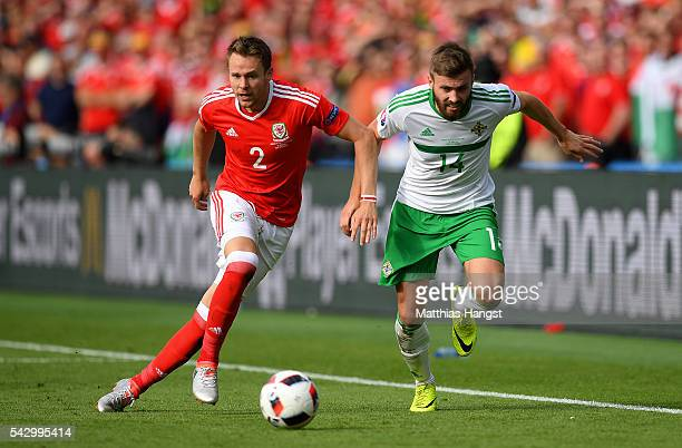 Chris Gunter of Wales and Stuart Dallas of Northern Ireland compete for the ball during the UEFA EURO 2016 round of 16 match between Wales and...