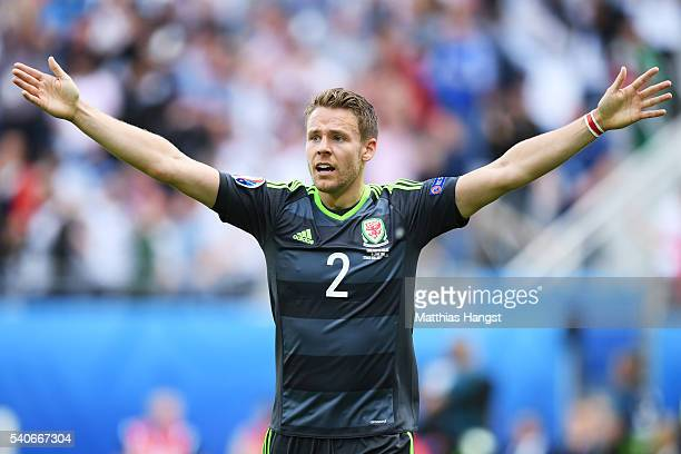 Chris Gunter of Wales protests after England's first goal during the UEFA EURO 2016 Group B match between England and Wales at Stade BollaertDelelis...