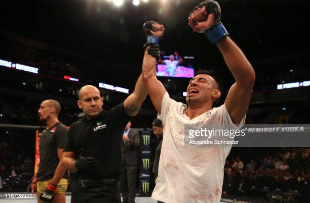Chris Gutierrez celebrates after defeating Geraldo de Freitas of Brazil in their bantamweight fight during the UFC Fight Night event at Antel Arena...