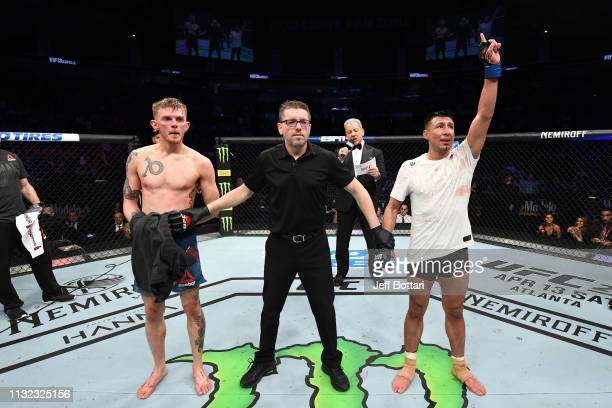 Chris Gutierrez celebrates his victory over Ryan MacDonald in their bantamweight bout during the UFC Fight Night event at Bridgestone Arena on March...
