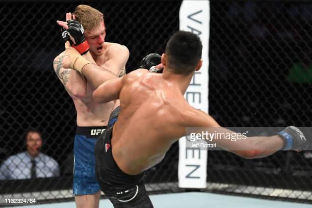 Chris Gutierrez kicks Ryan MacDonald in their bantamweight bout during the UFC Fight Night event at Bridgestone Arena on March 23, 2019 in Nashville,...