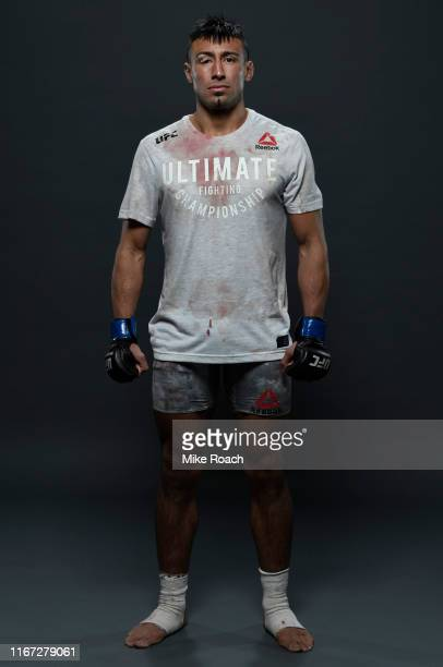 Chris Gutierrez poses for a portrait backstage after his victory during the UFC Fight Night event at Antel Arena on August 10 2019 in Montevideo...