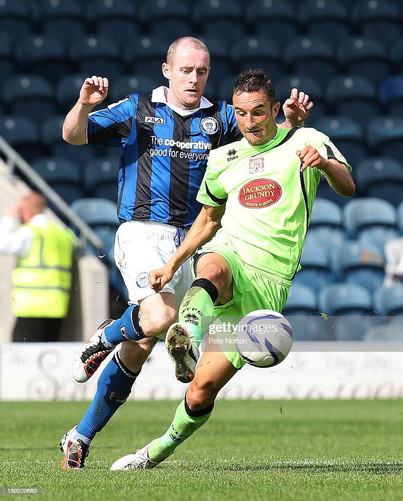 Chris Hackett of Northampton Town attempts to control the ball under pressure from Peter Cavanagh of Rochdale during the npower League Two match between Rochdale and Northampton Town at Spotland Stadium on August 18, 2012 in Rochdale, England.