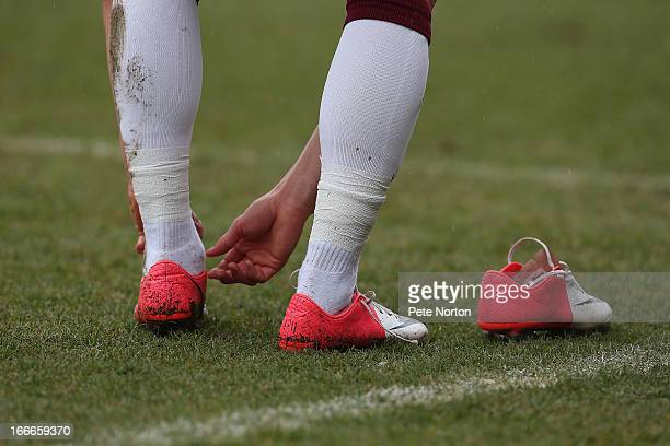 Chris Hackett of Northampton Town changes his boots during the npower League Two match between Northampton Town and York City at Sixfields Stadium on...