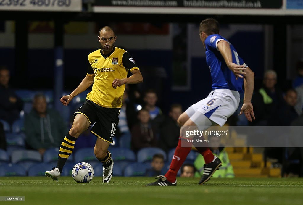 Chris Hackett of Northampton Town looks to move forward with the ball watched by Ben Chorley of Portsmouth to head the ball during the Sky Bet League Two match between Portsmouth and Northampton Town at Fratton Park on August 19, 2014 in Portsmouth, England.