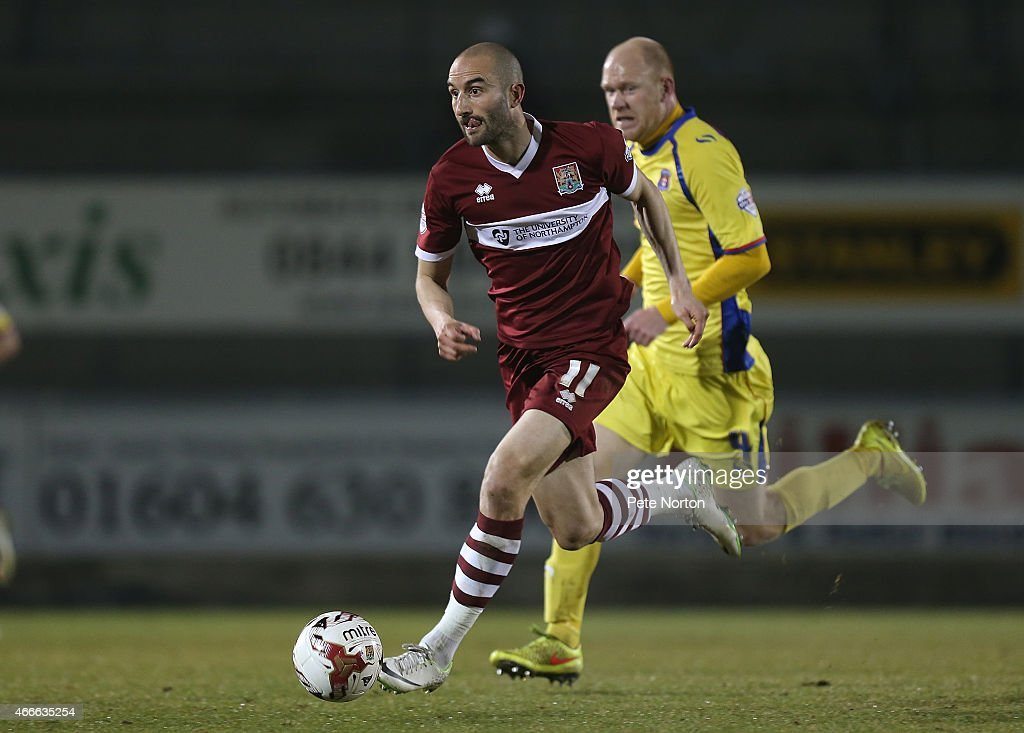 Chris Hackett of Northampton Town moves forward with the ball during the Sky Bet League Two match between Northampton Town and Carlisle United at Sixfields Stadium on March 17, 2015 in Northampton, England.