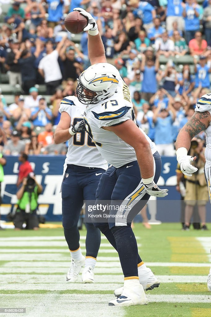 Chris Hairston #75 of the Los Angeles Chargers celebrates after Melvin Gordon #28 of the Los Angeles Chargers scores a touchdown during the game between the Los Angeles Chargers and the Miami Dolphins at the StubHub Center on September 17, 2017 in Carson, California.