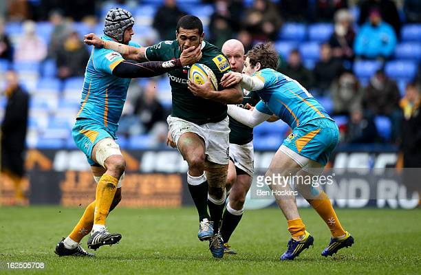 Chris Hala'Ufia of London Irish is tackled by Marco Wentzel and Elliot Daly of Wasps during the Aviva Premiership match between London Irish and...