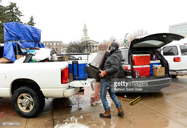 Chris Hale from Purple Haze loads a space heater and other items in to the back of a truck after the announcement that the 420 Rally had been...