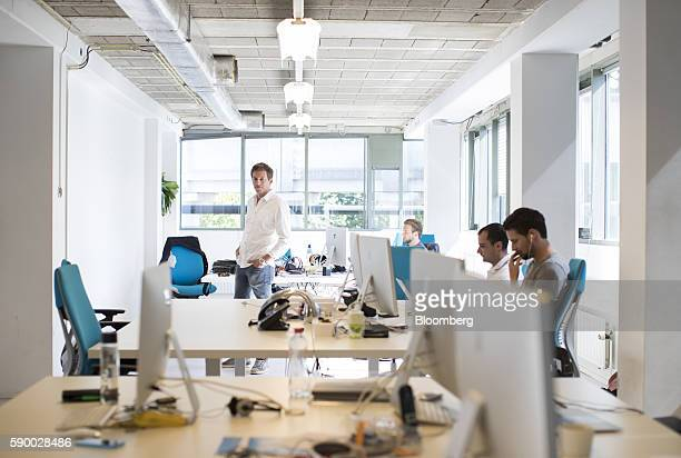 Chris Hall founder and chief executive officer of Bynder center poses for a photograph inside the company's headquarters in Amsterdam Netherlands on...