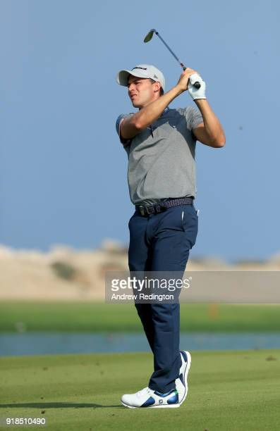 Chris Hanson of England plays his second shot on the par four 4th hole during the first round of the NBO Oman Open at Al Mouj Golf on February 15...