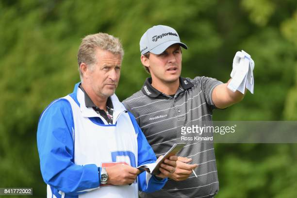 Chris Hanson of Englandspeaks with his caddie on the 5th tee during the continuation of round 2 on day 3 of the DD REAL Czech Masters at Albatross...