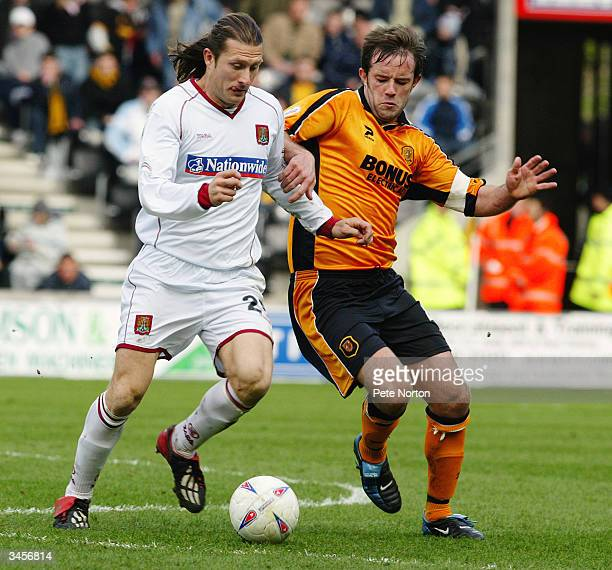 Chris Hargreaves of Northampton Town takes the ball past Ian Ashbee of Hull City during the Nationwide League Division Three match between Hull City...