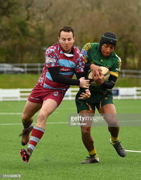 Chris Harmer of OPMs and Nicholas Bono Machado of Plymstock Albion Oaks compete for the ball during the Lockie Cup Semi Final match between Old...