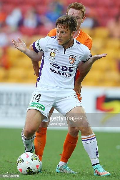 Chris Harold of Glory and Corey Brown of the Roar compete for the ball during the round eight ALeague match between Brisbane Roar and Perth Glory at...