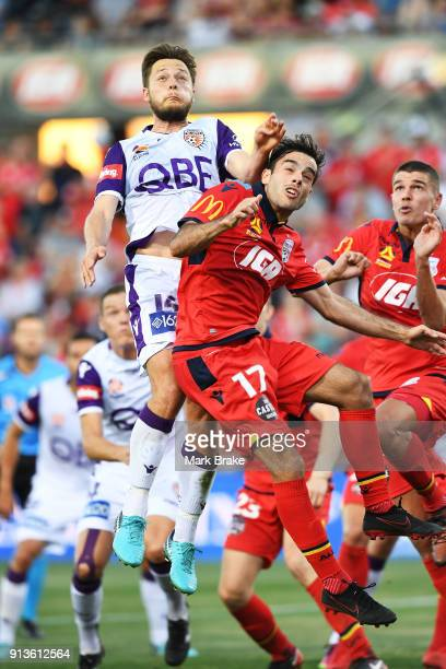 Chris Harold of Perth Glory heads for goal defended by Nikola Mileusnic of Adelaide United during the round 19 ALeague match between Adelaide United...