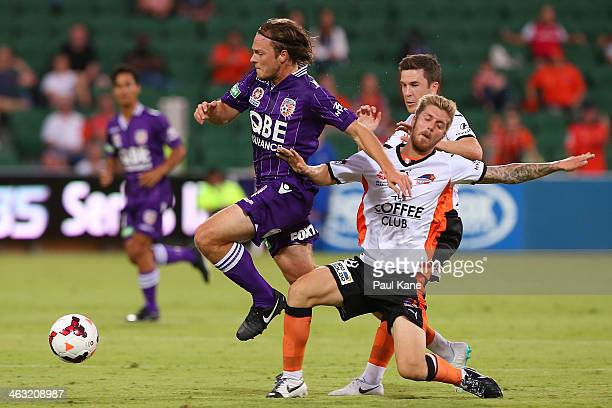 Chris Harold of the Glory and Luke Brattan of the Roar contest for the ball during the round 15 ALeague match between Perth Glory and the Brisbane...