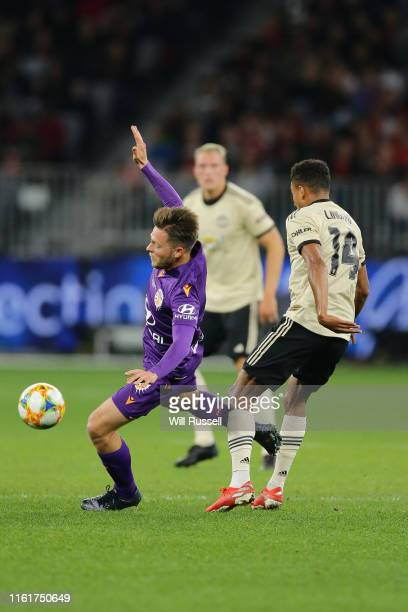 Chris Harold of the Glory is fouled by Jesse Lingard of Manchester United during the match between the Perth Glory and Manchester United at Optus...