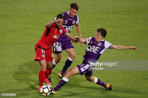 Chris Harold of the Glory tackles Nikola Mileusnic of the Reds during the round five ALeague match between the Perth Glory and Adelaide United at nib...