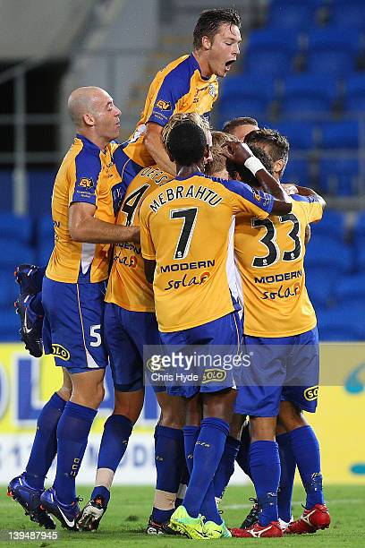 Chris Harold of United jumps over team mates after Ben Halloran scored a goal during the round 17 ALeague match between Gold Coast United and the...