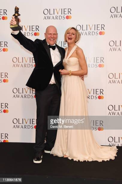 Chris Harper and Marianne Elliott winners of the Best Musical Revival award for 'Company' pose in the press room at The Olivier Awards 2019 with...
