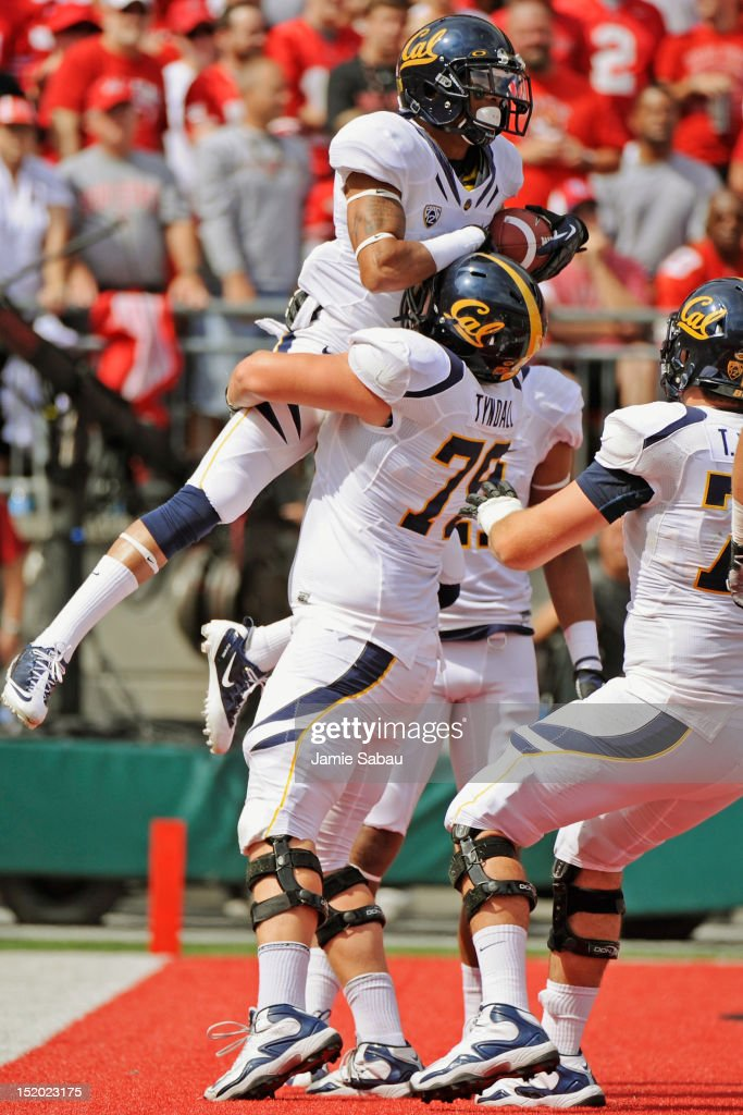 Chris Harper #6 of the California Golden Bears celebrates his 19-yard touchdown catch in the first quarter against the Ohio State Buckeyes with teammate Bill Tyndall #79 at Ohio Stadium on September 15, 2012 in Columbus, Ohio.