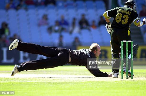 Chris Harris fields a ball from Yousaf Yohana during the 5th and deciding ODI cricket match between the Black Caps and Pakistan at Carisbrook Dunedin...