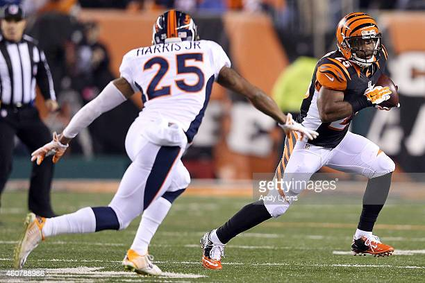 Chris Harris Jr #25 of the Denver Broncos chases after Giovani Bernard of the Cincinnati Bengals during the first quarter at Paul Brown Stadium on...