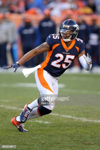 Chris Harris Jr #25 of the Denver Broncos looks on during the game against the New York Jets at Sports Authority Field At Mile High on December 10...