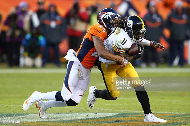 Chris Harris Jr #25 of the Denver Broncos tackles Markus Wheaton during the game against the Pittsburgh Steelers at Sports Authority Field At Mile...