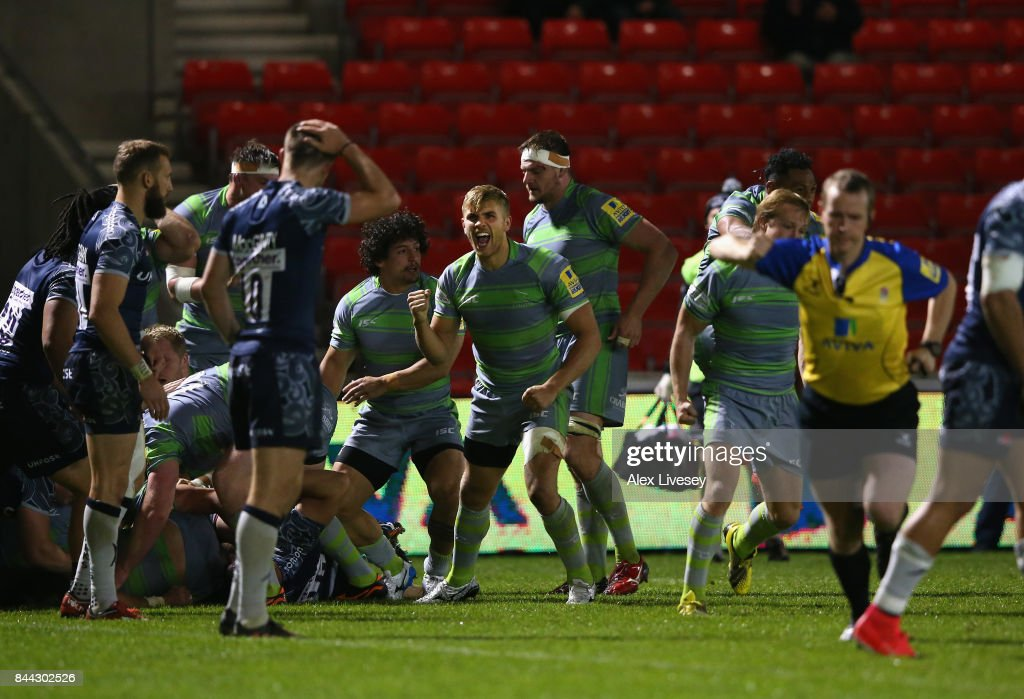 Chris Harris of Newcastle Falcons celebrates with team mates after they are awarded a penalty try to win the match during the Aviva Premiership match between Sale Sharks and Newcastle Falcons at AJ Bell Stadium on September 8, 2017 in Salford, England.