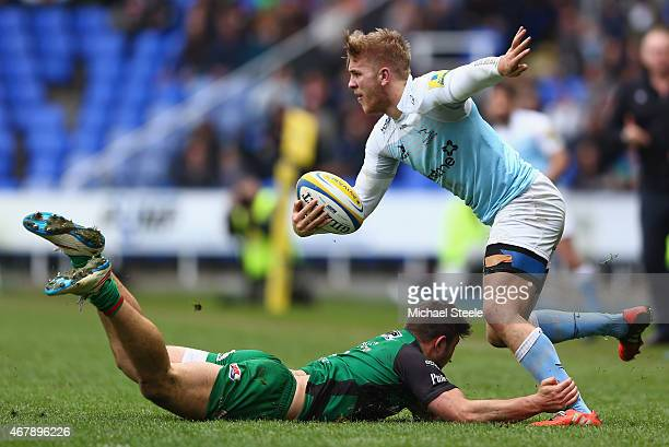 Chris Harris of Newcastle Falcons is held up by Tom Fowlie of London Irish during the Aviva Premiership match between London Irish and Newcastle...