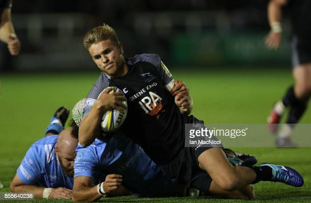 Chris Harris of Newcastle Falcons is tackled by Blair Cowan of London Irish during the Aviva Premiership match between Newcastle Falcons and London...