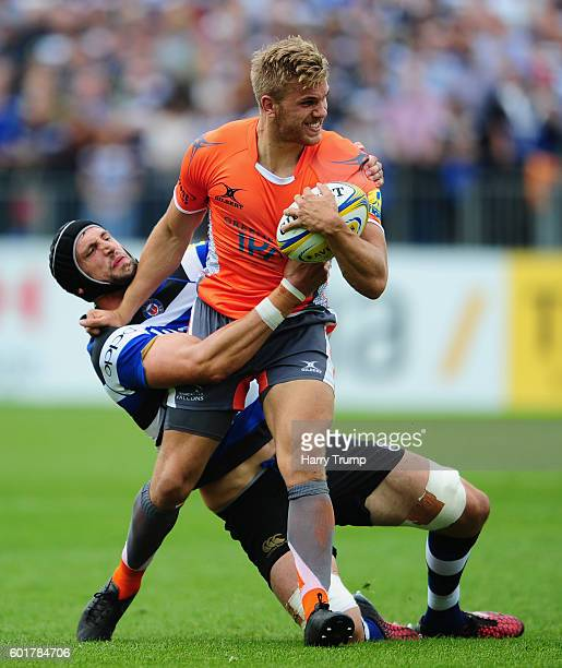 Chris Harris of Newcastle Falcons is tackled by Luke Charteris of Bath Rugby during the Aviva Premiership match between Bath Rugby and Newcastle...