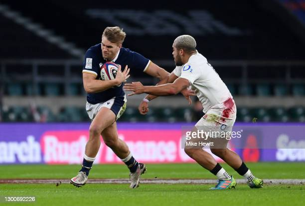 Chris Harris of Scotland hands off Ollie Lawrence of England during the Guinness Six Nations match between England and Scotland at Twickenham Stadium...