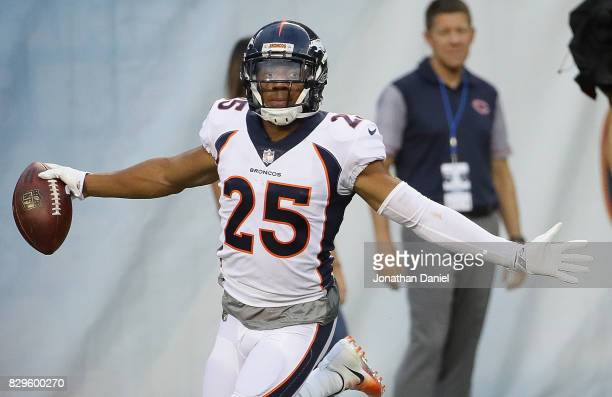 Chris Harris of the Denver Broncos celebrates after returning an interception for a touchdown against the Chicago Bears during a preseason game at...