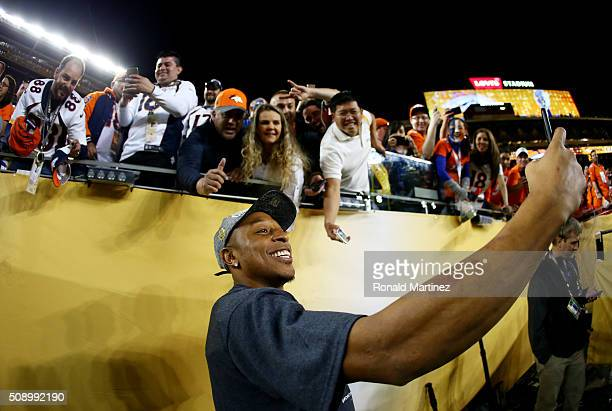 Chris Harris of the Denver Broncos celebrates and takes a selfie after defeating the Carolina Panthers during Super Bowl 50 at Levi's Stadium on...