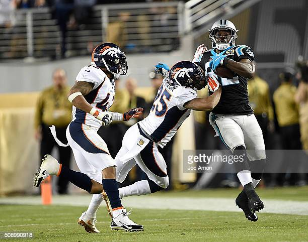 Chris Harris of the Denver Broncos pushes Jerricho Cotchery of the Carolina Panthers out of bounds in the fourth quarter The Denver Broncos played...