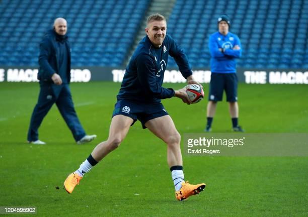 Chris Harris passes the ball during the Scotland captain's run at Murrayfield on February 07, 2020 in Edinburgh, Scotland.