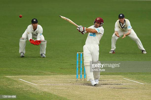 Chris Hartley of the Bulls hits the ball during day four of the Sheffield Shield match between the Queensland Bulls and the Victorian Bushrangers at...