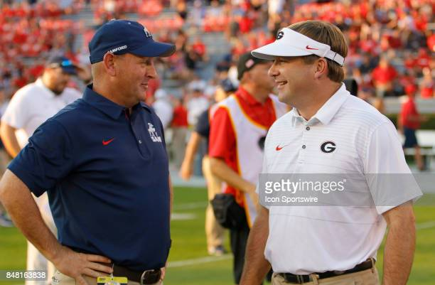 Chris Hatcher and Kirby Smart talk prior to the college football game between the University of Georgia Bulldogs and the Samford Bulldogs on...