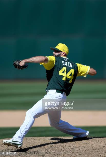 Chris Hatcher of the Oakland Athletics pitches against the Texas Rangers in the top of the eighth inning at Oakland Alameda Coliseum on August 27...